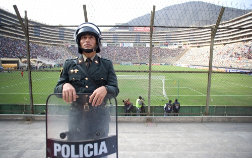 Police gaurd the first ten rows around the stadium.