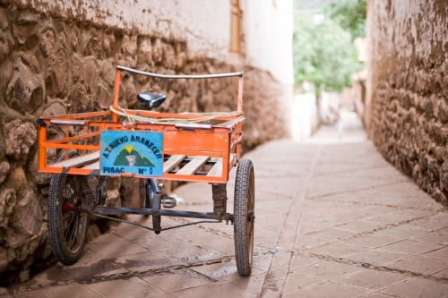 In Pisac Cusco Peru, cargo bikes and their owners disassemble the town's market on the Plaza every night and reassemble it every morning. These bikes move the tables, poles, tarps and goods every day, even on the weekends.
