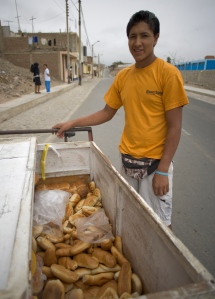 Boy poses with his bread bike in Huanchaco, Peru