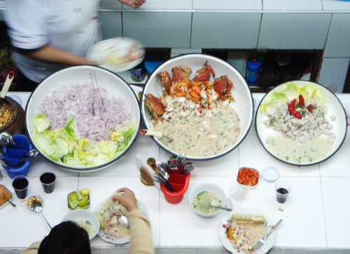 A look down into a ceviche restaurant stall in the Lima markets.