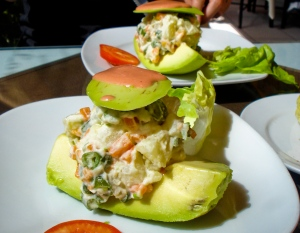 Stuffed avocado appetizer at a restaurant in Lima