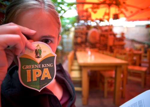 Jessie holding a beer coaster of a British IPA that was very yummy.