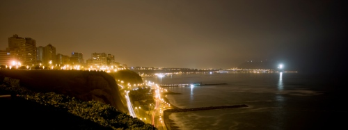 The coast at Miraflores Lima Peru, looking south to the cross dedicated to Pope John Paul II, which remains lit 24 hours a day.