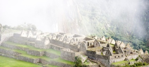 Machu Picchu's main square and housing area shrouded in fog.